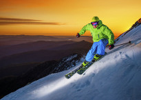 Mathis from Mt Buller Chalet Buller Sports enjoying a sunset ski on summit