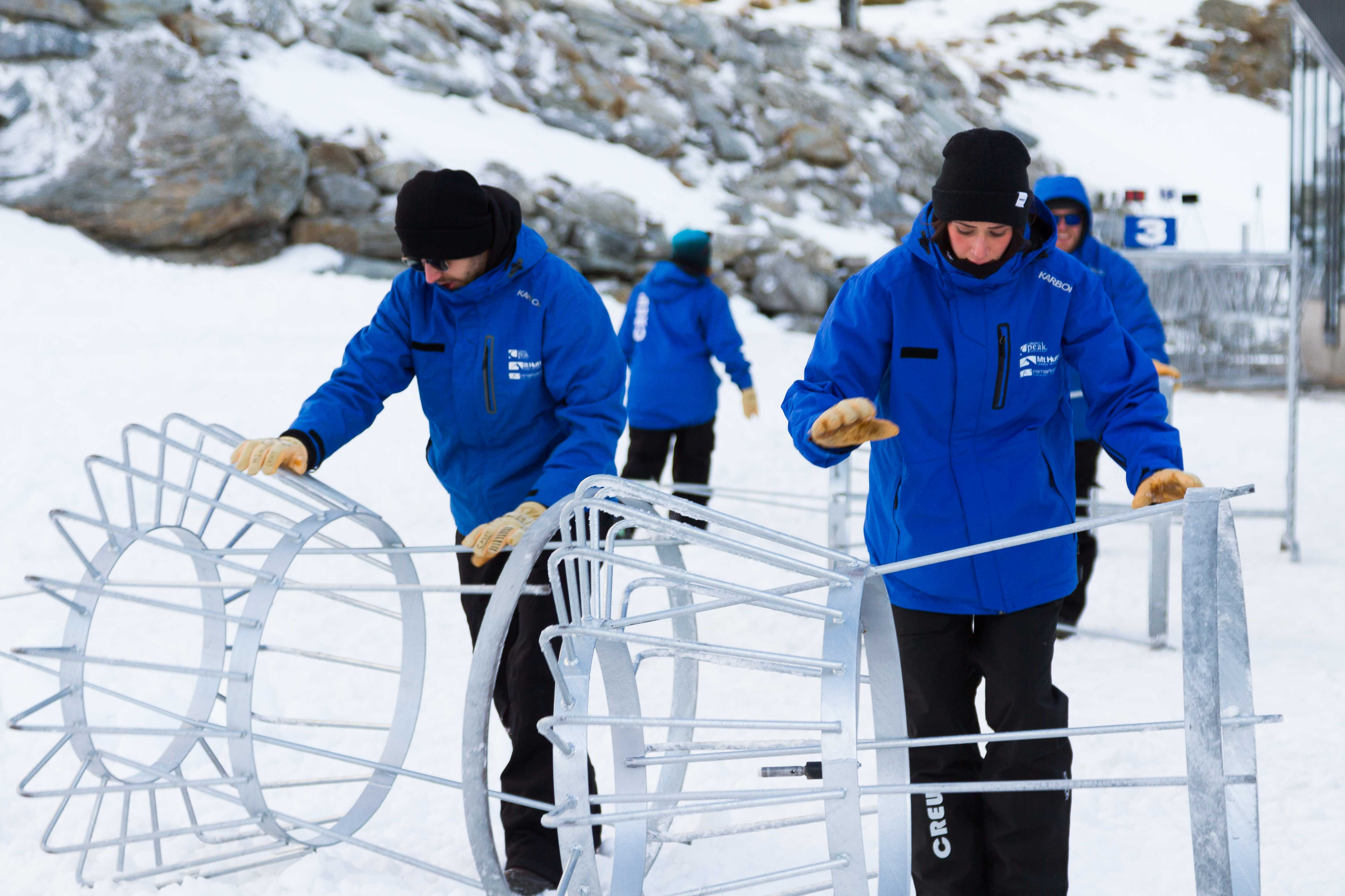 putting out the ski racks ready for first guests at the remarkables